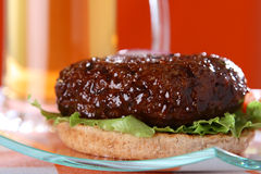 Juicy beef burger with beer on red background Royalty Free Stock Photo