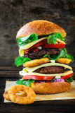 Juicy beef burger and onion rings Royalty Free Stock Image