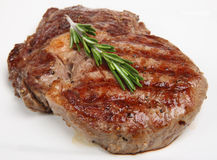 Juicy Beef Rib-Eye Steak Stock Images