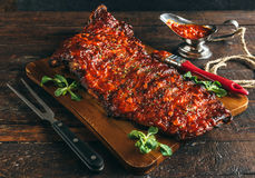 Juicy beef ribs. With homemade bbq sauce,selective focus royalty free stock image