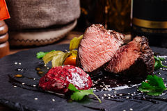 Juicy Beef rump steak from marble beef medium rare with spices a Stock Image