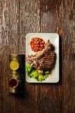 Juicy beef steak cut in slices on plate. view from above. dark wood background. Stock Images