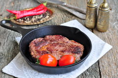 Juicy beef steak in a frying pan Stock Photo