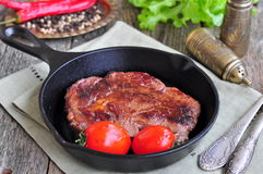 Juicy beef steak in a frying pan Royalty Free Stock Photography