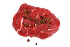 Juicy beef steak with peppercorns and thyme Royalty Free Stock Photos