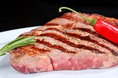 Juicy beef steak with red chili pepper Royalty Free Stock Photography