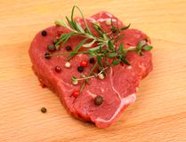 Juicy beef steak with spices and herbs Royalty Free Stock Photos