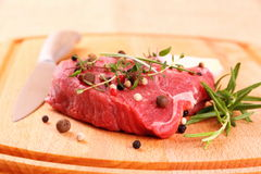 Juicy beef steak with spices, steel knife Royalty Free Stock Photos