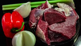 Fresh, juicy beef with vegetables royalty free stock photography