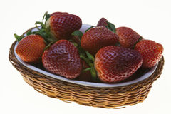 Juicy berries of ripe strawberries in a wicker basket on a white background. Juicy berries of ripe strawberries in a wicker basket on a white background Stock Photography