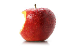 Juicy bite of a red apple Royalty Free Stock Photography
