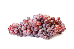 Juicy blue grapes on a white. Royalty Free Stock Photo