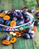 Juicy blue plum on a white plate Royalty Free Stock Images