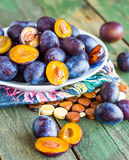 Juicy blue plum on a white plate, vertically Stock Photo