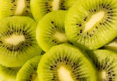 Juicy bright green kiwi fruits with seeds royalty free stock images