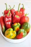 Lots of red peppers. Juicy, bright peppers in the dish stock photos