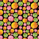Juicy Bright Watercolor Circle Pattern. Seamless kitchen texture with orange, green and pink juice drops on black background Stock Photo