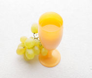 Juicy bunch of grapes and a glass Stock Images