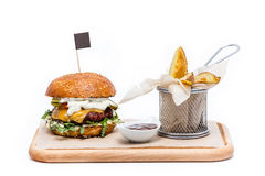 Juicy burger with fries. Juicy burger with french fries, isolated Royalty Free Stock Photos