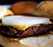 Juicy Cheeseburger With A Slice Of Onion Royalty Free Stock Photos