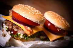 Juicy cheeseburgers Stock Images
