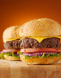 Juicy cheeseburgers vertical composition. Stock Images