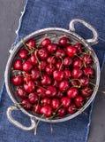 Juicy cherries in round metal bowl stock photo
