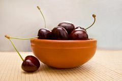 Juicy cherry in the bowl Stock Images