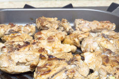Juicy chicken meat in a frying pan Royalty Free Stock Photography