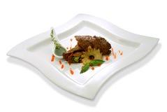 Juicy chop with sauce Stock Photos