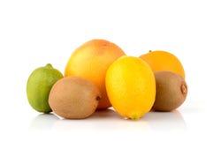 Juicy citrus fruits. On white Stock Photos