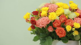 Juicy, colorful bouquet of pink, yellow, red and orange roses, close-up stock video