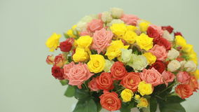Juicy, colorful bouquet of pink, yellow, red and orange roses, close-up stock footage