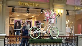 Juicy Couture. Moscow, Russia - March 15, 2017: Juicy Couture store in GUM department store or Central Universal Department Store. People walk near the stock footage