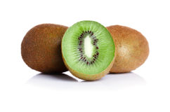 Juicy cut in a half kiwi fruit and whole kiwis fruit, on a white background. Close-up of kiwi fruit with a thin royalty free stock photo