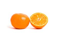 Juicy cut orange. Isolated on white background Royalty Free Stock Photos
