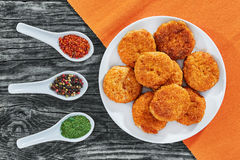 Juicy delicious fried chicken cutlets on white dish Royalty Free Stock Photography
