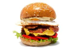 Juicy burger of beef on a white background. royalty free stock photography