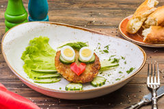 Juicy delicious meat fried cutlets with hot mashed potatoes, green lettuce leaves, on a white plate. royalty free stock images