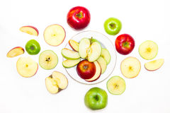 Juicy, delicious, ripe apples green and red on a white background. а juicy, delicious, ripe apples green and red on a white background Royalty Free Stock Photos