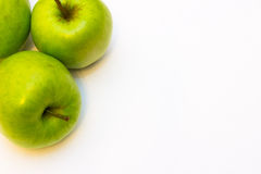 Juicy, delicious, ripe apples green on a white background. а juicy, delicious, ripe apples green on a white background Stock Photography