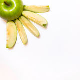 Juicy, delicious, ripe apples green on a white background. а juicy, delicious, ripe apples green and red on a white background Royalty Free Stock Photos