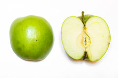 Juicy, delicious, ripe apples green on a white background. а juicy, delicious, ripe apples green and red on a white background Royalty Free Stock Images