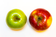 Juicy, delicious, ripe apples red and green on a white background. а juicy, delicious, ripe apples green on a white background Stock Images
