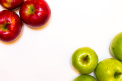 Juicy, delicious, ripe apples red and green on a white background. а juicy, delicious, ripe apples green and red on a white background Royalty Free Stock Photos