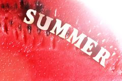 Juicy delicious watermelon and wooden text letters summer. Sunny mood royalty free stock photos