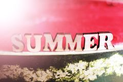 Juicy delicious watermelon and wooden text letters summer. Sunny mood stock photo
