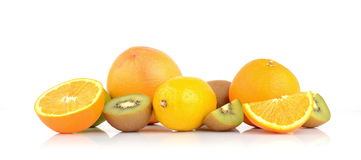 Juicy exotic fruits. Studio shot of juicy exotic fruits  on white Royalty Free Stock Images