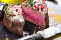 Juicy Fillet Steak with Fresh Herbs Royalty Free Stock Image
