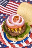 Juicy fourth of July hamburger Royalty Free Stock Photo